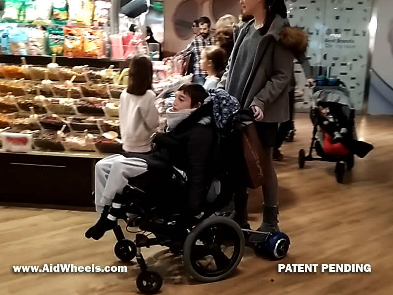 wheelchair hoverboard strolling