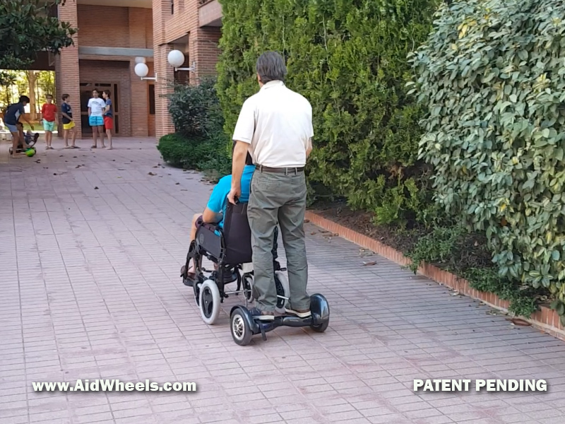 power assist wheelchair devices assitant caregiver
